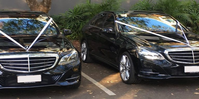 Two black limousines