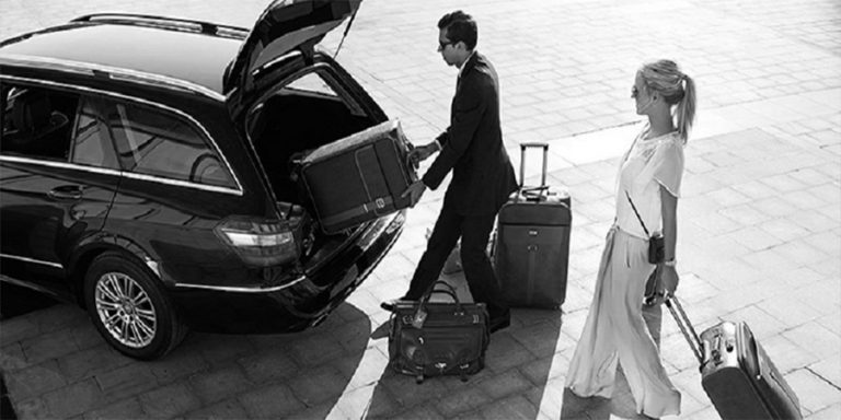 Brisbane chauffeur placing baggage into limousine