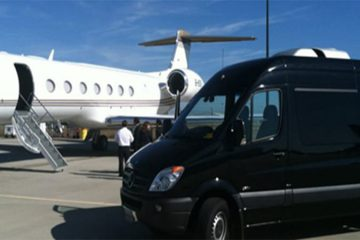 Sprinter van parked in front of private jet